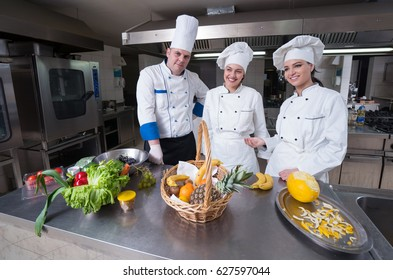 Chefs Cooking, Cutting and preparing next plate