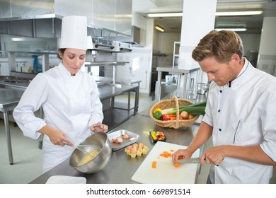 chefs cooking in kitchen