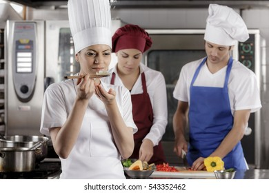 Chefs and cooks at work in a professional kitchen