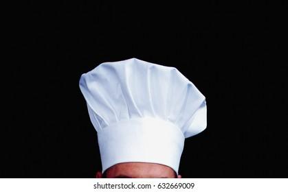 Chefs hat against black background