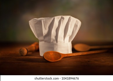 chef's hat with wooden spoons