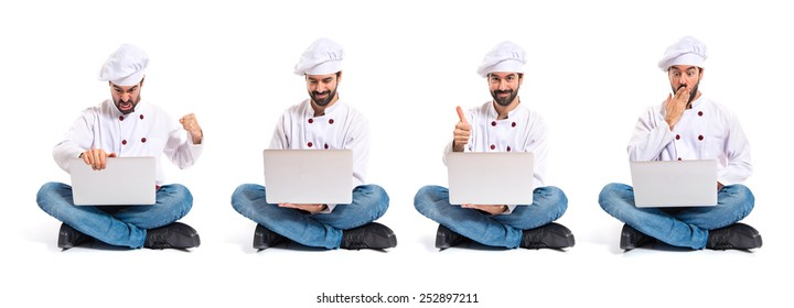 Chefs with laptop over white background