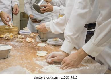 Chefs make dim sum at the famous restaurant Din Tai Fung.Asian food, dumplings, Make dumplings