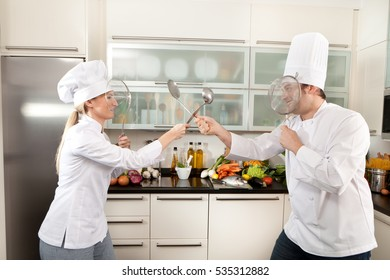 chefs making fencing and having fun in the kitchen