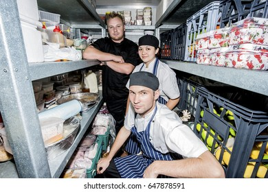 Chefs with nice look working at kitchen, luxury house or hotel inside rooms, daytime scene with perfect lights, they are enjoying a festival or party.