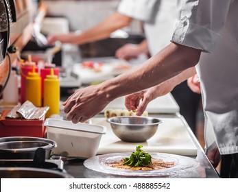 Chefs preparing food in the restaurant kitchen