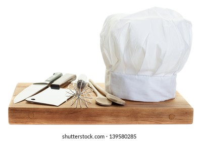 A chef's toque with various cooking utensils
