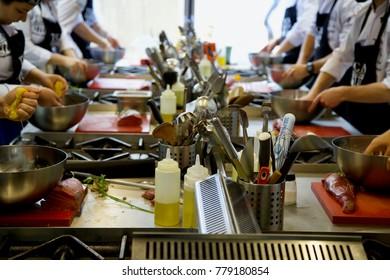 Chefs At Work In The Restaurant Kitchen