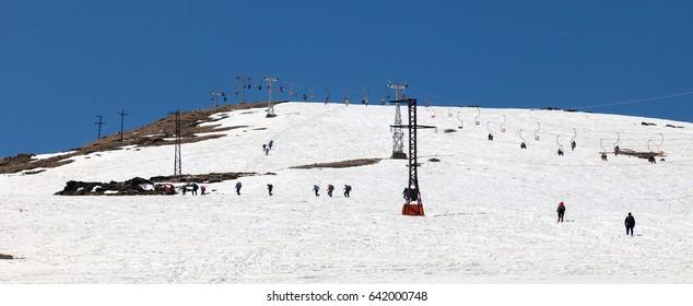 Cheget Mountain, ski slopes on a sunny spring day.