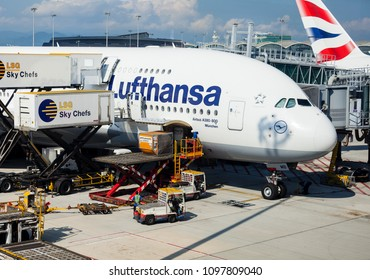 Chek Lap Kok, Hong Kong - May 17 2018: A Lufthansa A380 aircraft is being catered and cleaned as passengers disembark while cargo is unloaded after arriving at Hong Kong International Airport .