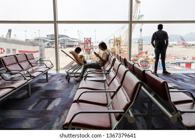 Chek Lap Kok / Hong Kong - April 10th 2019: A father is waiting for air flight with his son.