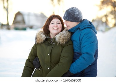 Chekhov, Moscow region, Russian Federation, January 7, 2019, a man and a woman are hugging in the winter in the park