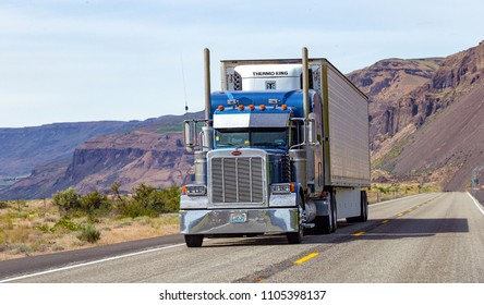 Chelan, Washington state, USA - May 30, 2018: Semi truck with trailer driving on highway