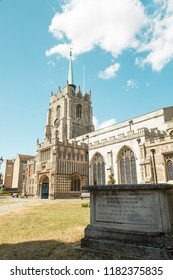 Chelmsford Cathedral - Essex, UK 09/07/2018: A beautiful exterior view of Chelmsford Cathedral with a tomb in front.