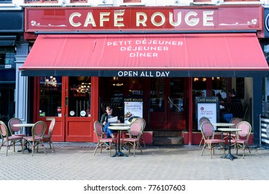 CHELMSFORD, ENGLAND 7TH NOVEMBER 2017 - Man sitting reading a newspaper at the popular Cafe Rouge exterior taken during the day in Chelmsford Essex England