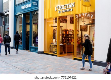 CHELMSFORD, ENGLAND 7TH NOVEMBER 2017 - Shoppers during the daytime walking past a L'Occitane chocolate shop in Bond Street Chelmsford