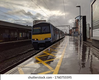 CHELMSFORD, ENGLAND - NOVEMBER 27 2019: A Greater Anglia class 321 arrives at Chelmsford in Essex.