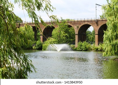Chelmsford, England - A train viaduct spans across Central Park