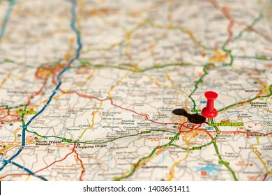 Chelmsford, Essex, UK - Circa May 2019: Shallow focus of the capital city of Essex. The centre of the city is located with the push-pin. Part of the large road network can be seen on the paper planner
