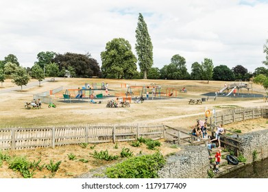 Chelmsford, Essex, UK - July 28, 2018: English families enjoying beautiful sunny Saturday, children playing on the playground and relaxing by the river in Chelmsford, Essex - UK