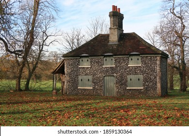 Chelmsford, Essex, United Kingdom, November 22, 2020. Historic Flint cottage grounds of Hylands public park. Autumn fall colours and leaves. Chelmsford, Essex, United Kingdom, November 22, 2020.