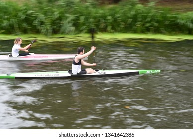 CHELMSFORD, ESSEX/ENGLAND - 18TH AUGUST 2018 - Rowers row their boats on the River Chelmer using the local waterways as part of their watersport activity in the busy city of Chelmsford