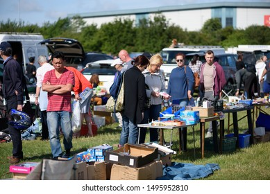 CHELMSFORD, ESSEX/ENGLAND - JUNE 1ST 2019 - People visiting a car boot sale in Boreham Essex where they can buy cheap and unusual items during the summer of 2019