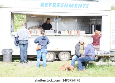 CHELMSFORD, ESSEX/ENGLAND - JUNE  1ST 2019 - People visiting a car boot sale in Boreham Essex buying fast food bugers and where they can also buy cheap and unusual items during the summer of 2019