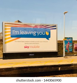 Chelmsford, UK - 5 July 2019: I'm leaving you - break up with your network partner by text. sky mobile advert at the train station.