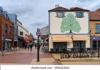 Chelmsford / United Kingdom - March 17 2017: The center Tindal square and pedestrian shopping street in small Eastern English town. Tree shaped decoration on the side of the house.