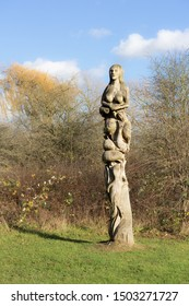 Chelmsford / United Kingdom - March 23 2017: Statue from carved tree trunk depicting woman body, fish and other figure. It is placed into public park in Eastern England.