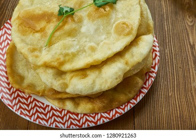 Chelpek,  traditional Central Asian flatbread, Kyrgyz  cuisine, Traditional assorted dishes, Top view.