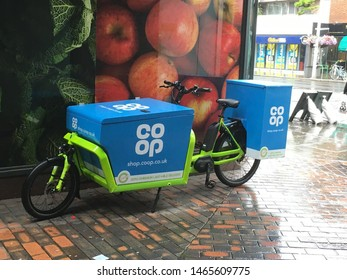 Chelsea, London / United Kingdom - July 27 2019; Co-op delivery e-bike outside a Co-op supermarket.