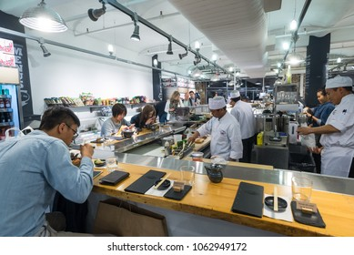 Chelsea Market, New York City - 18th May 2016: People eating at a Japanese restaurant in the Chelsea market, The Market has a variety of food markets, restaurants and retail stores.