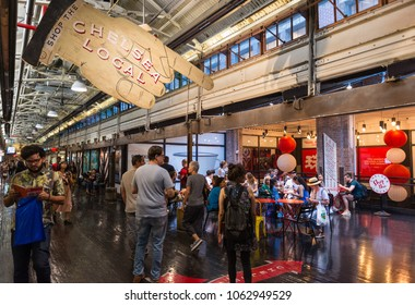 Chelsea Market, New York City - 24th September, 2017: People walking through the Chelsea market in New York, The Chelsea Market has a variety of food markets, restaurants  and retail stores.