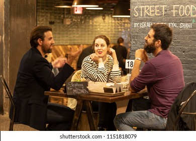 CHELSEA MARKET, NEW YORK CITY, USA - 14 MAY 2018: Market food in Chelsea neighborhood district Manhattan NYC, people eating in cafe restaurant
