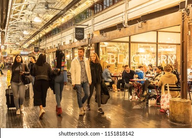 CHELSEA MARKET, NEW YORK CITY, USA - 14 MAY 2018: People, visitors, tourists, in the historic Chelsea Market, Manhattan, New York City