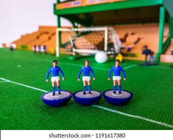 Chelsea Subbuteo football figures lined up on a grass field