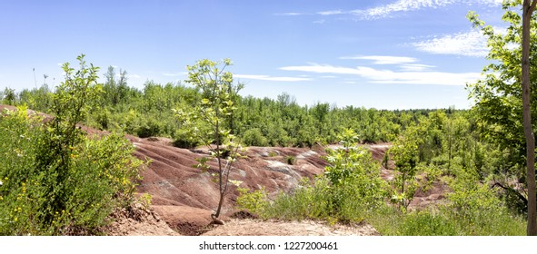 """The Cheltenham Badlands in Caledon in summer, Ontario, Canada. """"Badlands"""" is a geologic term for an area of soft rock devoid of vegetation and soil cover."""