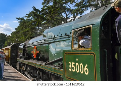 CHELTENHAM, ENGLAND - SEPTEMBER 2019: The driver of the Peninsular and Oriential locomotive at Cheltenham Racecourse Station on the Gloucestershire and Warwickshire Steam Railway.