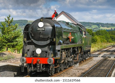 CHELTENHAM, ENGLAND - SEPTEMBER 2019: The Peninsular and Oriential steam locomotive approaching Cheltenham Racecourse Station on the Gloucestershire and Warwickshire Steam Railway.