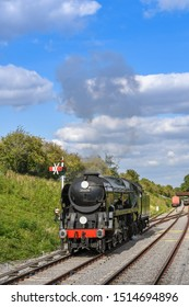CHELTENHAM, ENGLAND - SEPTEMBER 2019: The Peninsular and Oriential steam locomotive approaching Broadway Station on the Gloucestershire and Warwickshire Steam Railway.