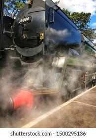 CHELTENHAM, ENGLAND - SEPTEMBER 2019: Steam rising from a steam locomotive on the Gloucestershire and Warwickshire steam railway at Cheltenham Racecourse station