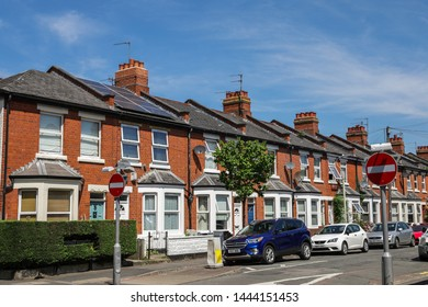 Cheltenham Gloucestershire UK 5th JULY 2019 Alstone Avenue Cheltenham - One house with a solar panel in a row of Victorian terraced houses with cars parked outside.