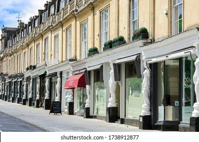 Cheltenham Gloucestershire UK May 21st 2020 Row of exclusive shops in the Regency buildings in the Montpellier shopping district of Cheltenham