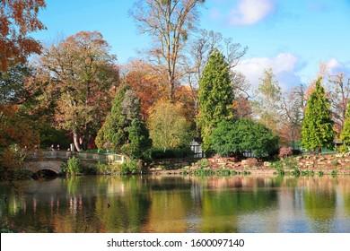 Cheltenham, Gloucestershire UK November 7th 2019 The bridge and boathouse on Pittville Lake, Pittville Park, Cheltenham Gloucestershire UK in autumn