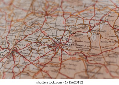 Cheltenham, Gloucestershire / United Kingdom - April 26 2020: A aged vintage map showing the famous town of Cheltenham in England, home to the renowned Cheltenham Festival of horse racing