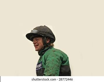 CHELTENHAM, GLOUCS, APRIL 17 2009:  Winning jockey Robert Chocolate Thornton returns muddy from winning on Bensalem in the second race at the April National Hunt meeting at Cheltenham Racecourse, UK