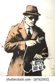 CHELTENHAM UK - APRIL 16, 2014 - Street art on wall in Cheltenham, possibly Banksy - GCHQ theme