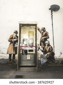 CHELTENHAM UK - APRIL 16, 2014 - Street art on wall in Cheltenham, possibly Banksy - GCHQ theme